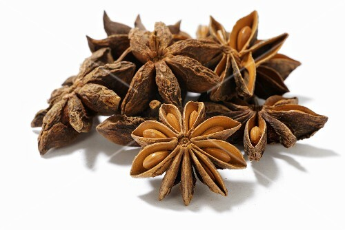 Several star anise on white background