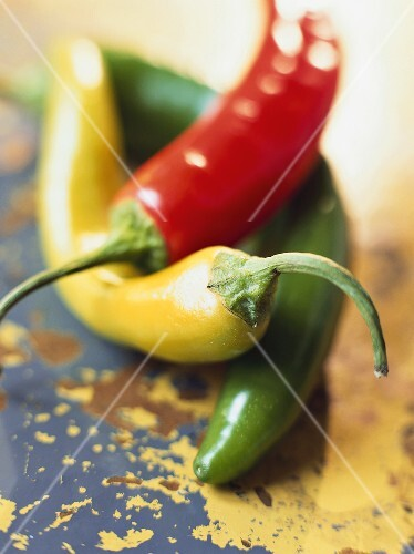 Yellow, red and green chili peppers