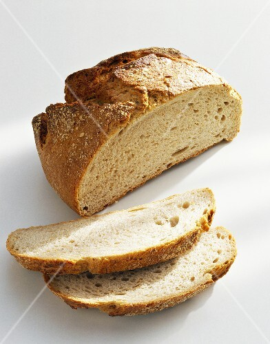 Potato bread, partly sliced