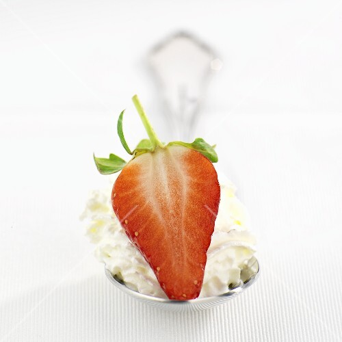 Strawberry and cream on spoon