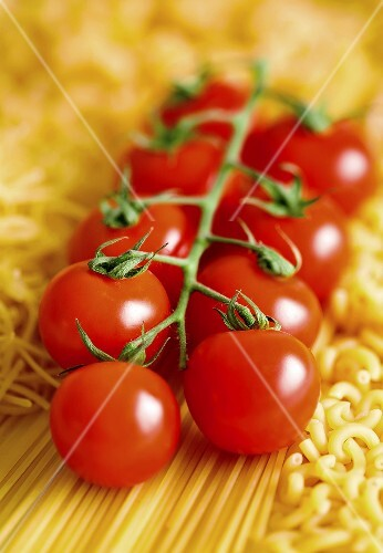 Tomatoes on the vine on pasta