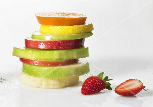 Slices of different fruit, stacked