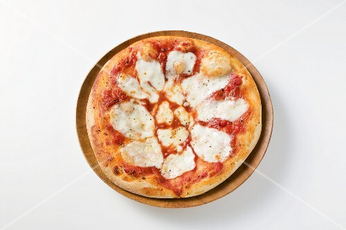 Pizza topped with tomato sauce and mozzarella
