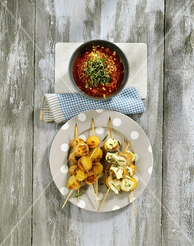 Potato kebabs with Brie and tomato dip