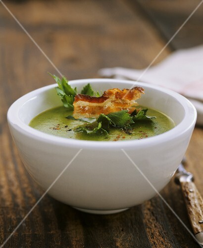 Green potato and celery soup with strips of bacon