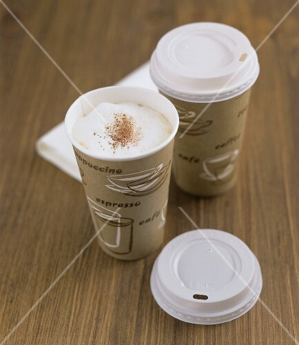 Coffee with milk froth in paper cups (Coffee to go)