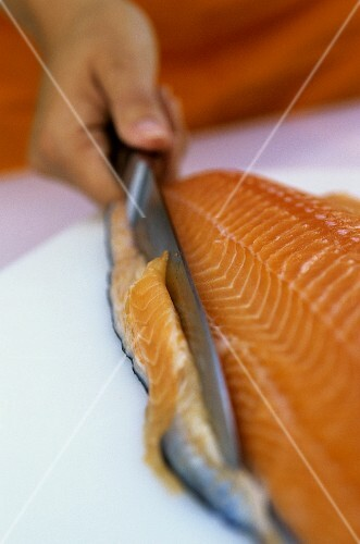 Filleting salmon (trimming the edge)