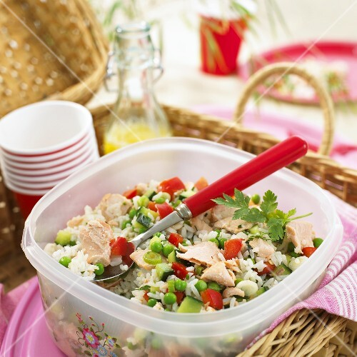 Rice and vegetable salad with salmon for a picnic