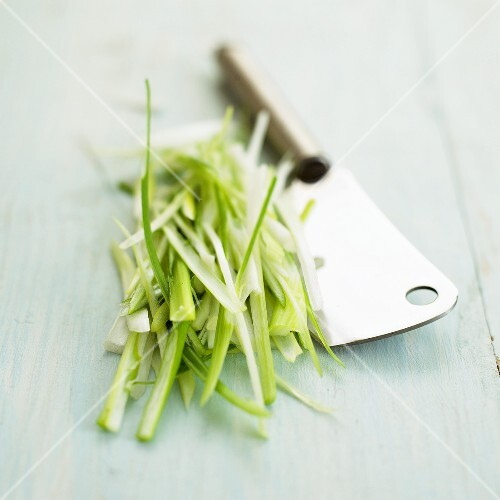 Chopped spring onions with cleaver