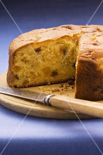 Apricot cake with chocolate chips, a piece removed