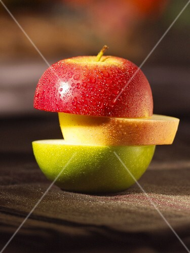 An apple sliced in three