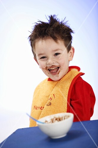 Small boy in bib after eating