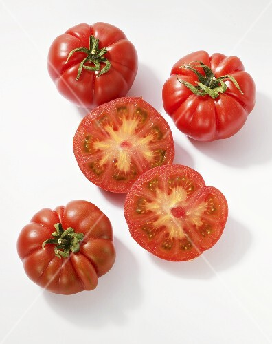 Oxheart tomatoes, whole and halved