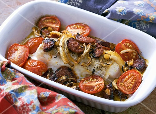 Cod fillet with chorizo, tomatoes and onions