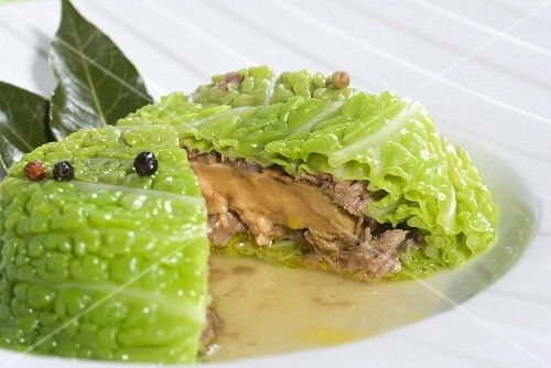 Stuffed savoy cabbage with foie gras, peppercorns and bay leaves