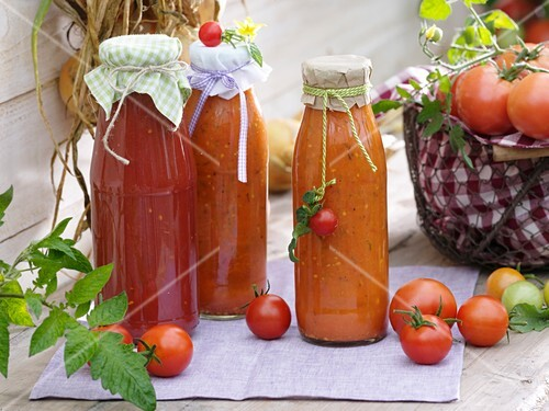 Bottles of home-made tomato pesto, tomatoes