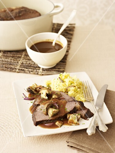 Braised beef with mashed potatoes and ceps