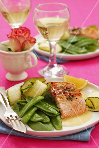 Salmon with Hollandaise sauce, mange tout and courgette