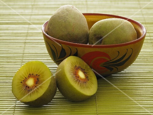 Chinese kiwis in a bowl and on the side