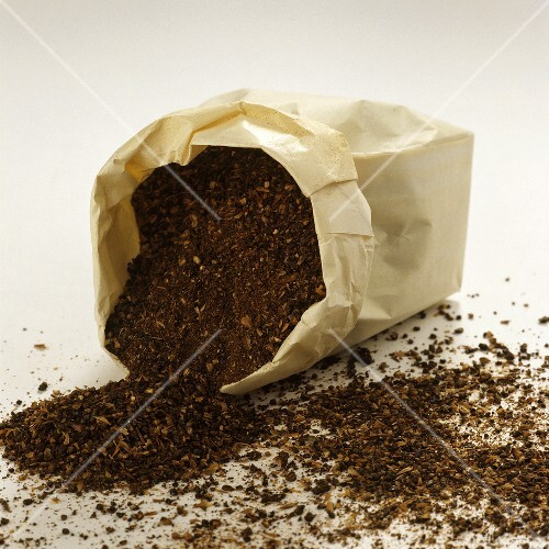 Barley coffee falling out of a paper bag