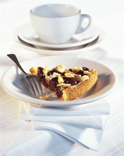 A piece of cherry tart with crunchy topping