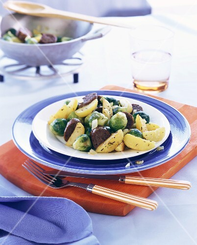 Pan-cooked potato & Brussels sprout dish with sausage pieces