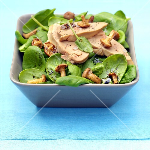 Spinach salad with goose foie gras and chanterelles
