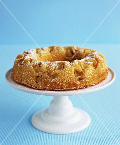 Apple ring cake on a cake stand