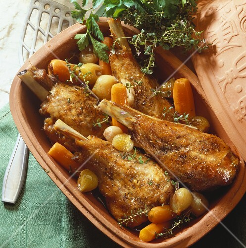 Turkey legs with carrots and shallots in Romertopf