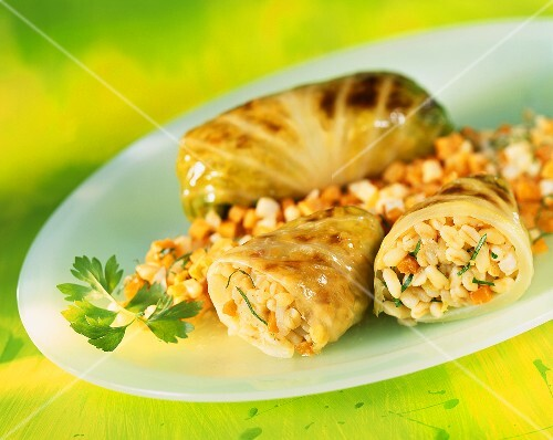 Cabbage leaves stuffed with pearl barley and carrots
