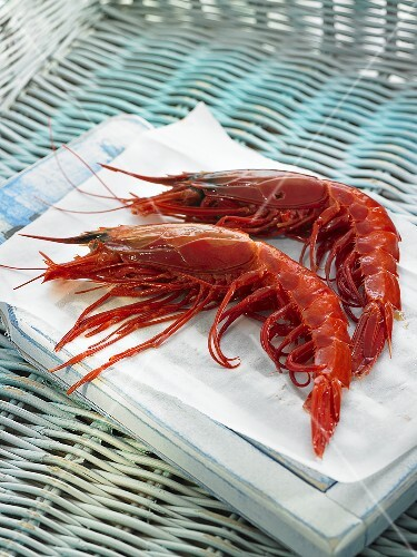 Two Palamos prawns on a piece of paper in a basket
