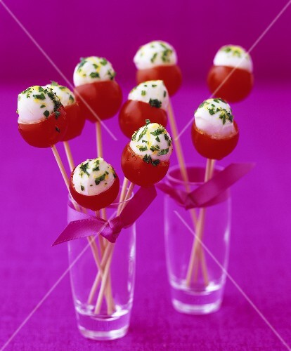 Cocktail tomatoes stuffed with mozzarella on cocktail sticks