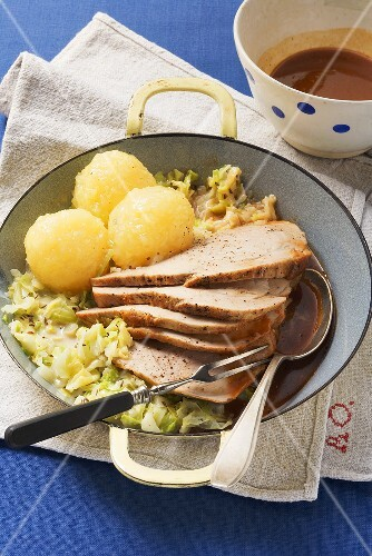 Roast pork with cabbage and potato dumplings