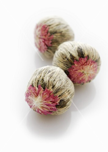 Three jasmine tea balls