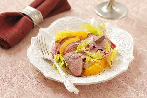Orange salad with duck breast and celery