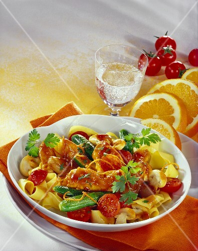 Honey chicken with mixed vegetables and ribbon pasta