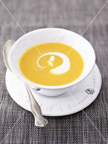 Pumpkin soup with crème fraîche in soup cup