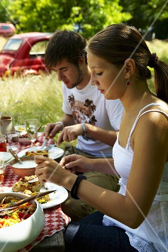 Young couple at Italian barbecue