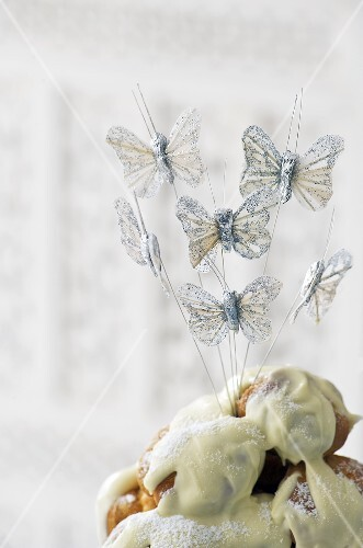 Iced cake with butterfly decoration