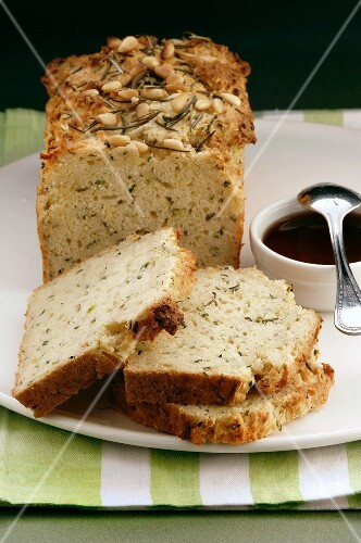 Spiced loaf with herbs and pine nuts, partly sliced