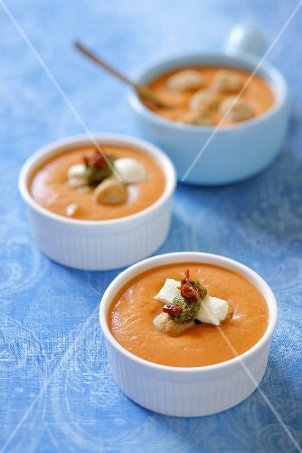 Cream of tomato soup with mozzarella, pesto and dried tomatoes