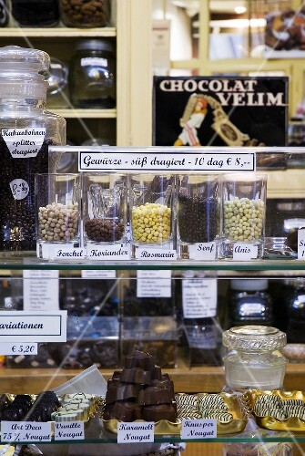 Comfits (candied spices) and chocolates in a sweet shop