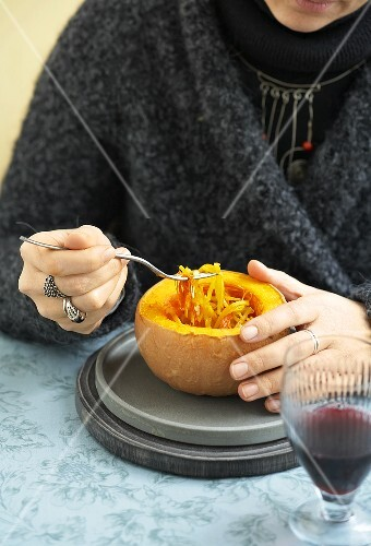 Woman eating spaghetti squash with saffron