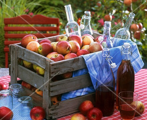 Crate of apples and bottles of juice