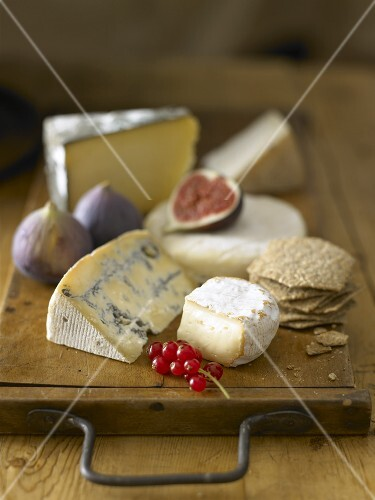 Various cheeses, redcurrants and figs