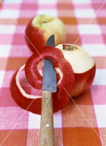 Peeling an apple and cutting into a spiral