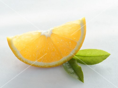 A wedge of orange with two leaves