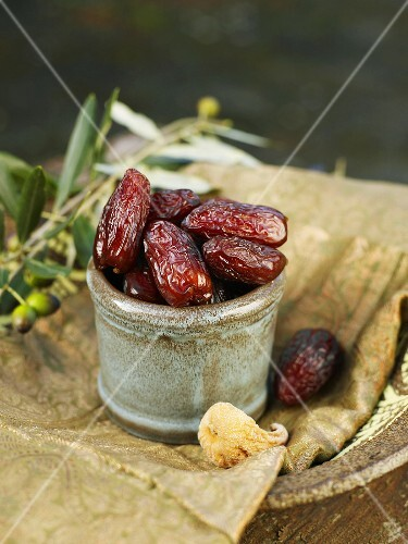 Dried dates in ceramic pot