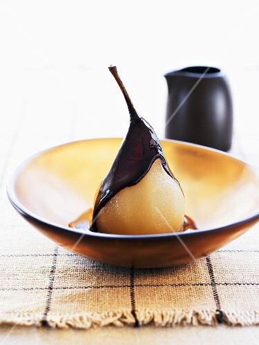 Poached vanilla pear with chocolate sauce