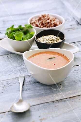 Tomato soup made with coconut milk, sunflower seeds, coriander, rice